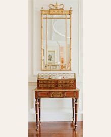 Adam-style mirror above rosewood and brass inlaid Bonheur du Jour