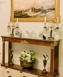 Antique console, candlesticks and painting