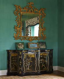 Chippendale style giltwood mirror above chinoiserie Cabinet inlaid with mother of pearl